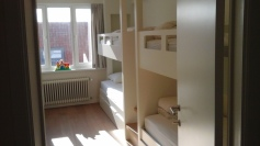 Bedroom 1 - 2 x 2 bunk beds with small central staircase + baby bed + sink